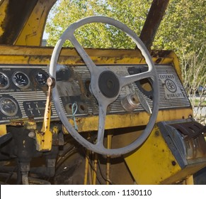 Old tractor cab with steering wheel