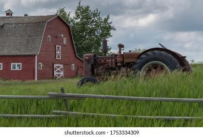 Old tractor in a field, Drumheller, Red Deer River, Alberta, Canada