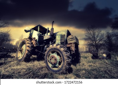 old tractor on the grass field - Shutterstock ID 1722472156