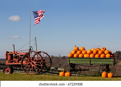 Old tractor with a pumpkin wagon