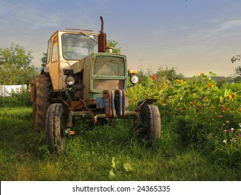 An old tractor standing on the field