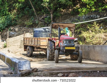 Old tractor with a trailer at a water pipeline construction