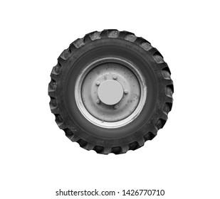 Old tractor or truck wheel isolated on white background.