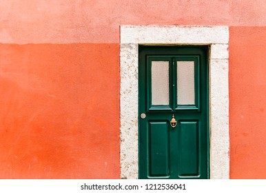 Old tradition portugues door of the house with colorful wall