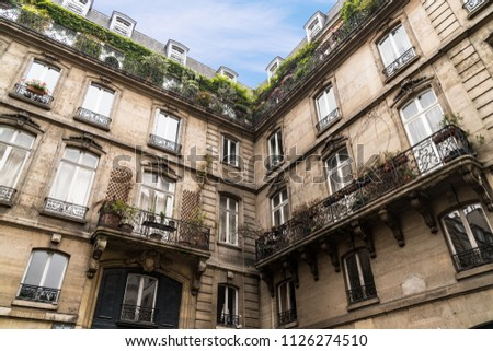 Old Traditional Apartment Building with Windows and Balconies in Paris France