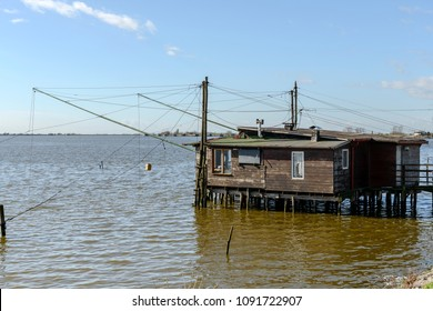 old traditional fishing hut on the brackish lagoon, shot in bright spring sun light at Comacchio, Ferrara,  Italy