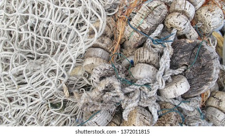 Old traditional fishing net with cork floaters and ropes, detail, close view