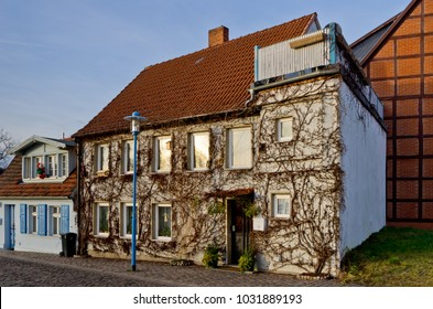 Old traditional German village house covered with ivy