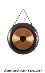 old traditional gong percussion instrument tom-tom isolated on white hanging on a rope