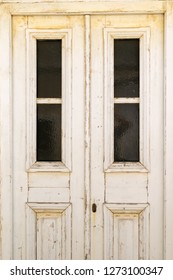 Old traditional house door at Andros island in Greece.