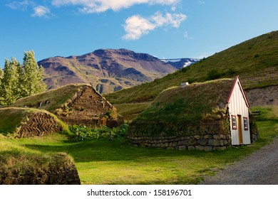 Old traditional Icelandic farm with mossy roofs at Laufas.