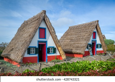 Old traditional Madeira exlorer's houses at Santana - the symbol of Madeira island and touristic spot. Portugal.