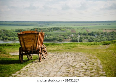 Old traditional medieval european wooden cart on the road