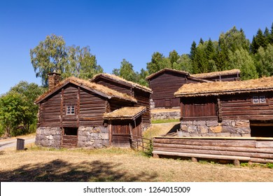 Old traditional Norwegian sod or turf roof log houses at Maihaugen Folks museum Lillehammer Oppland Norway Scandinavia