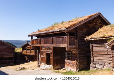 Old traditional Norwegian wooden sod roof houses at Maihaugen Folks museum Lillehammer Oppland Norway Scandinavia