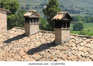 Old traditional rooftop chimneys constructed of bricks on a traditional medieval house