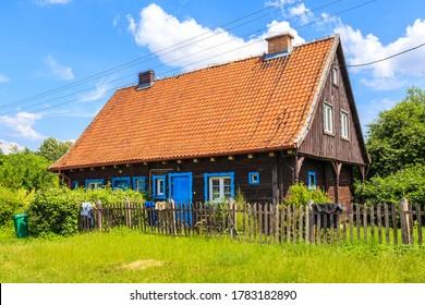 Old traditional rural house in Popielno village near lake Beldany, Masurian Lakes, Poland