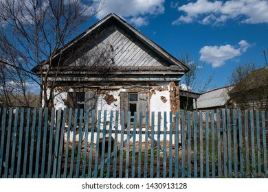 Old traditional russian wooden house behind the fence