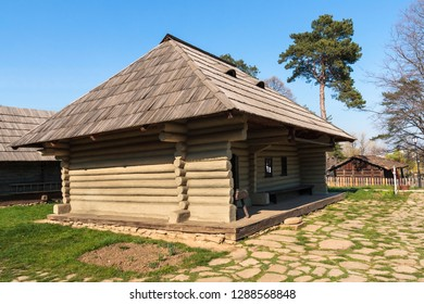 Old traditional rustic wooden house coated with clay, with wide porch, from Suceava county, Romania.