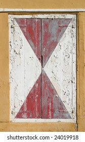 Old traditional shutter window on a colonial building in Curacao