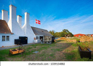 Old traditional smokehouse characteristic chimneys in Hasle, Bornholm, Denmark. This is the place, where you can taste the most popular dish on the island  Sol over Gudhjem (Sun over Gudhjem)