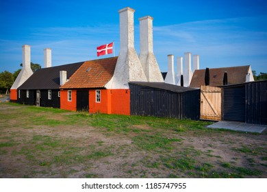 Old traditional smokehouses with characteristic chimneys in Hasle, Bornholm, Denmark. This is the place, where you can taste the most popular dish on the island - Sol over Gudhjem