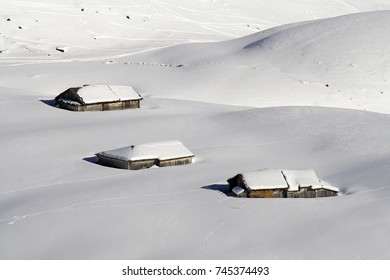Old, traditional Swiss wooden farm nearly hidden in the snow near Grindelwald. Alm at the Scheidegg area, Swiss alps, Berner Oberland, Switzerland.
