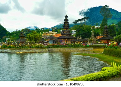 Old traditional temple complex in the mountain valley lake with green garden plantation for people to relax meditate and pray
