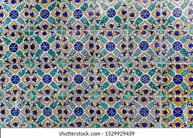 Old traditional Tunisian tiles.  Handmade Tunisian tiles with floral patterns. Islamic mosaic art pattern. Background of vintage ceramic tiles