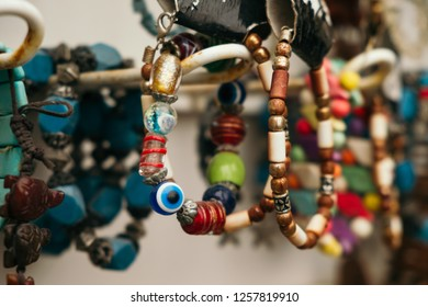 Old traditional turkish decoration on market. Bracelet with turkey amulet from eye evil