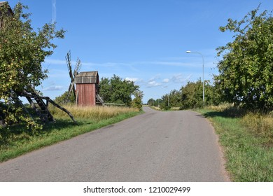 Old traditional windmill by roadside at the swedish island Oland