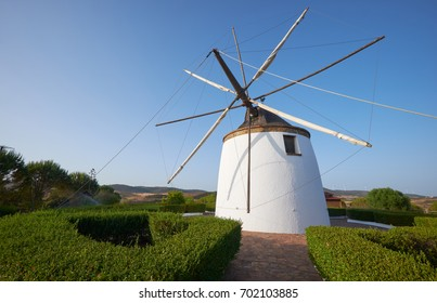 Old traditional windmill on the hill near country town  El Granado in Andalusia, Spain