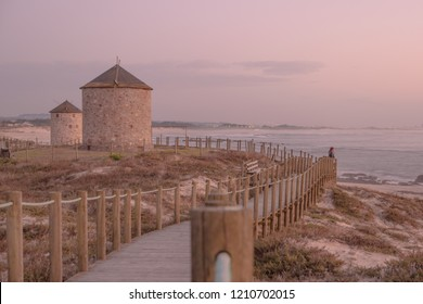 Old traditional wind-mills in sand-hills of Apulia Portugal