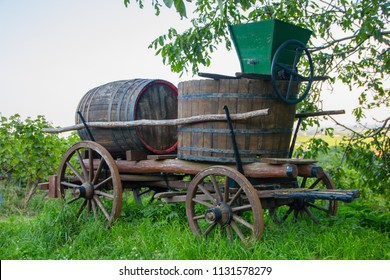 Old and traditional wood waggon with barrel and wine production tools in the old style how wine production took place in the last century