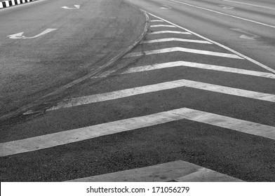 Old traffics lines on road.