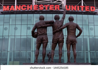 Old Trafford, Manchester/UK - July 6 2019: Shots of Old Trafford football ground home to Manchester United football club. MUFC. Shots show the red lettering of the club, some with statues in front.