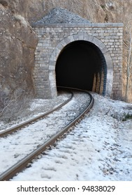 Old train brick tunnel with railway in a mountain