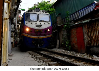 An old train going through the famous Train Street in Hanoi, Vietnam