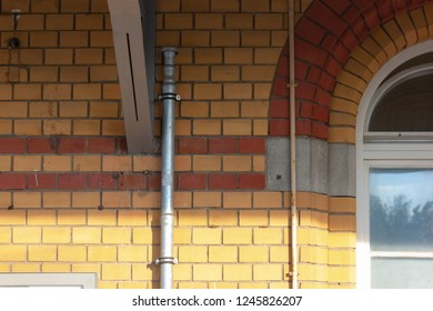 old trainstation entrance with brick wall and iron door in bavaria south germany