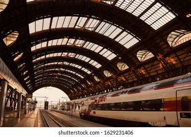 old trainstation with modern train in milan italy