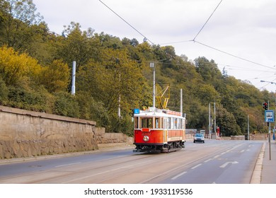 The old tram in the street of Prague, Czech. Quay of the Vltava river. The Prague tram network is the third largest in the world.