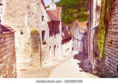Old tranquil street of Besancon with brick houses