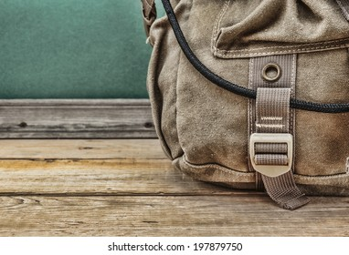 old travel backpack on the floor