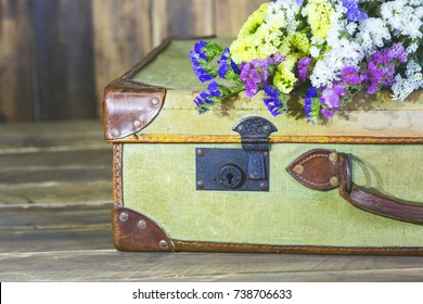 Old travel bag with delicate flowers