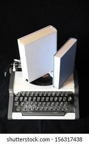 An Old Travel Vintage Typewriter on a Black Background
