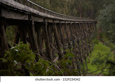 An old trestle bridge disappears into the distance.