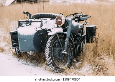 Old Tricar, Three-Wheeled Motorbike Of Wehrmacht, Armed Forces Of Germany Of World War II Time In Winter Forest.