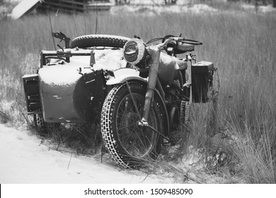 Old Tricar, Three-Wheeled Motorbike Of Wehrmacht, Armed Forces Of Germany Of World War II Time In Winter Forest. Photo In Black And White Colors.