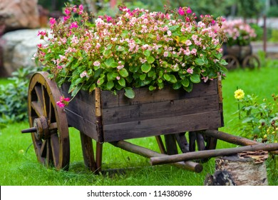 An old truck with flowers.