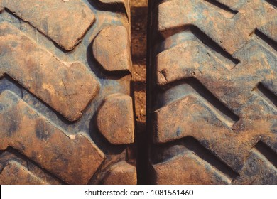 old truck tires lie in the landfill, worn and dirty